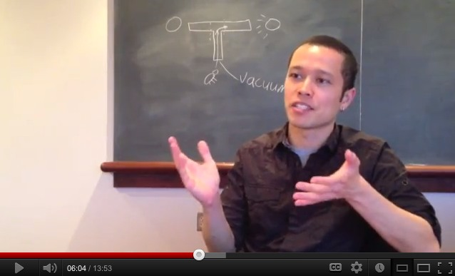 Still frame from movie about FlyVac with Jamey gesturing